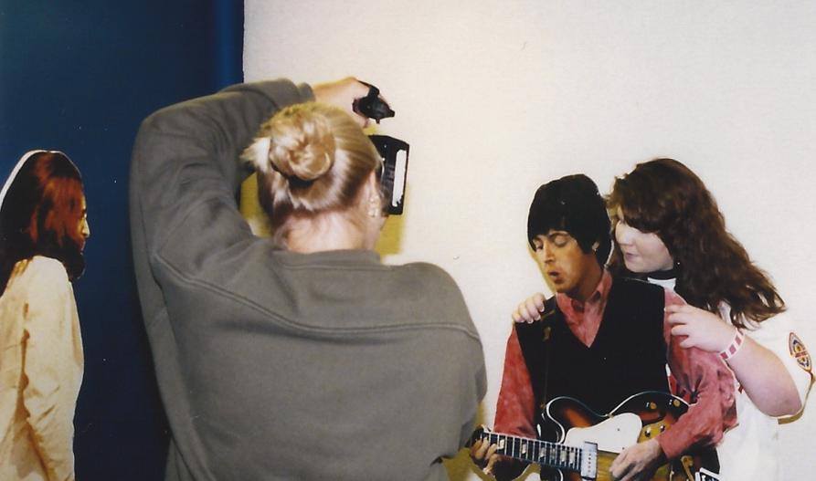 John looks on as a fan hugs Paul – Chicago `98