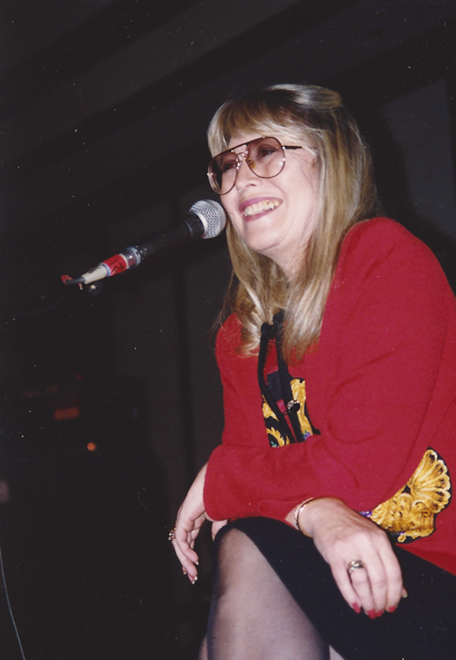 Cynthia Lennon flashes a smile for the attendees