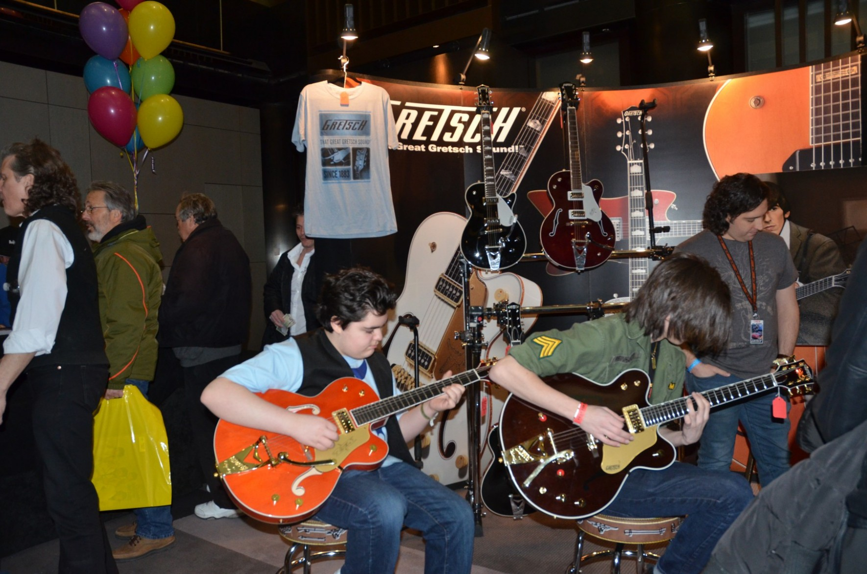 Fest attendees enjoy the Gretsch George Harrison exhibit outside The Cavern ballroom.