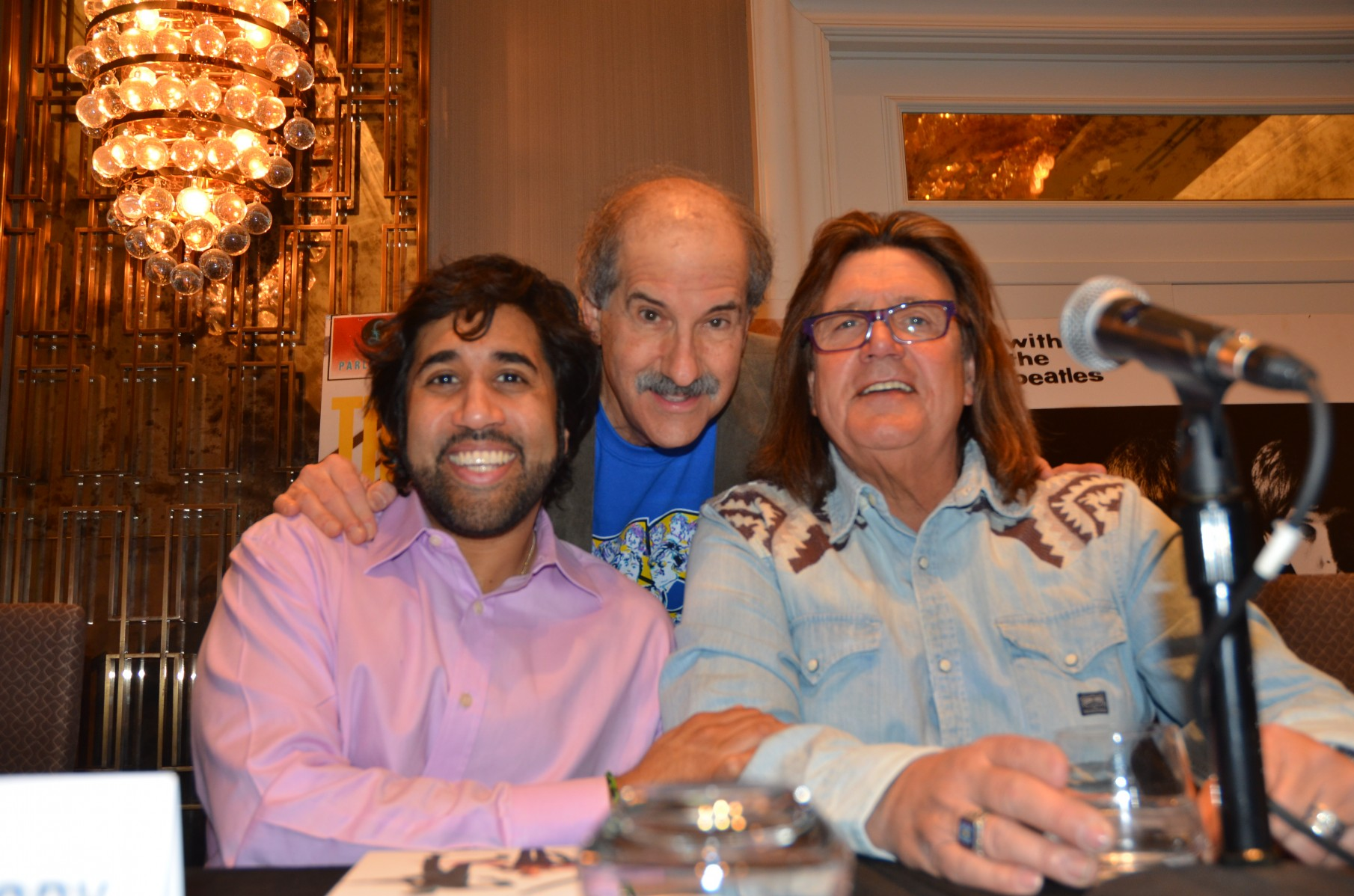 "Mark Lapidos is all smiles with ""Fifth Beatle"" author Vivek Tiwary and Liverpool legend Billy J. Kramer."