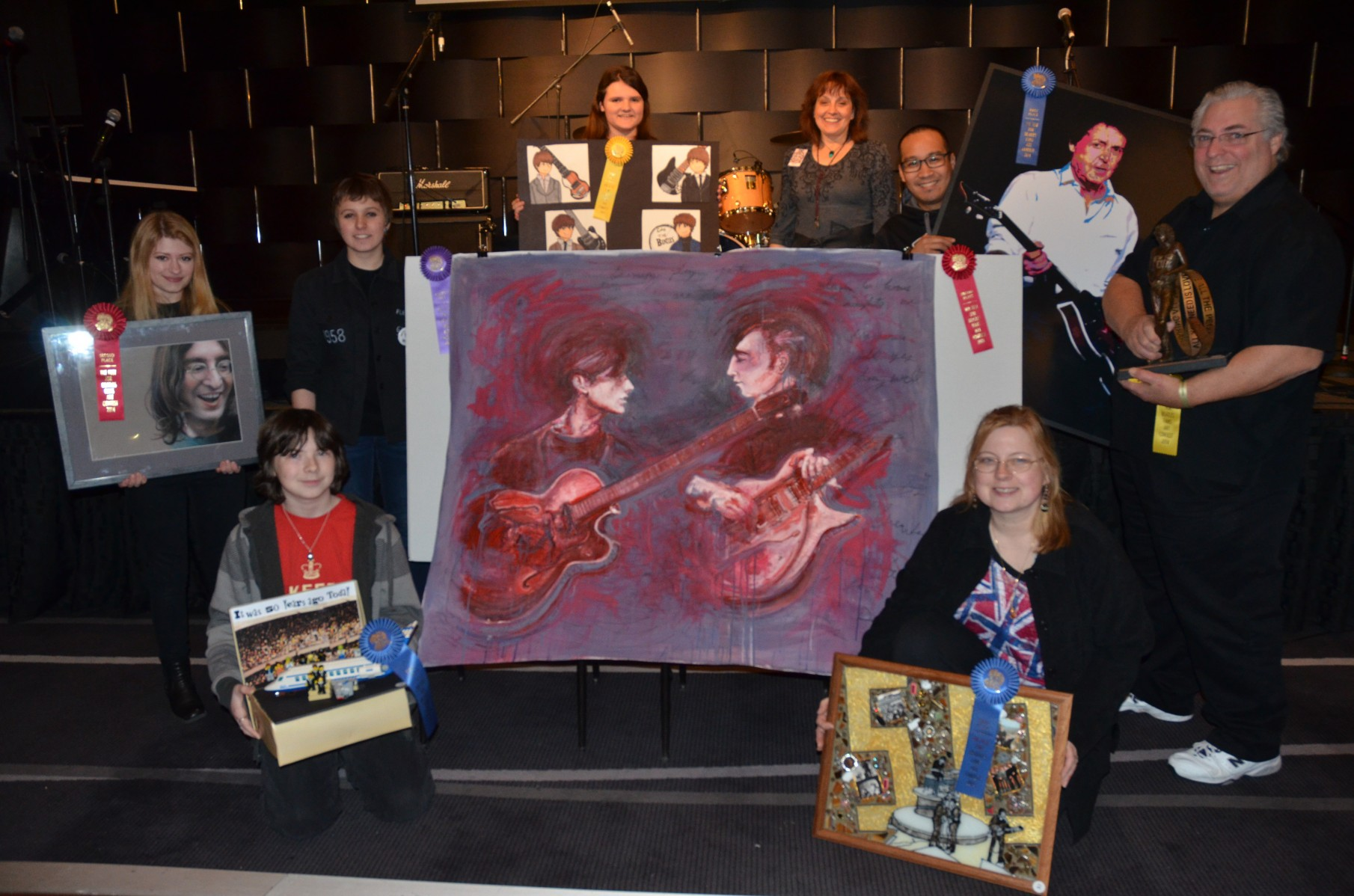 All of the Fest art contest winners pose in the Cavern.