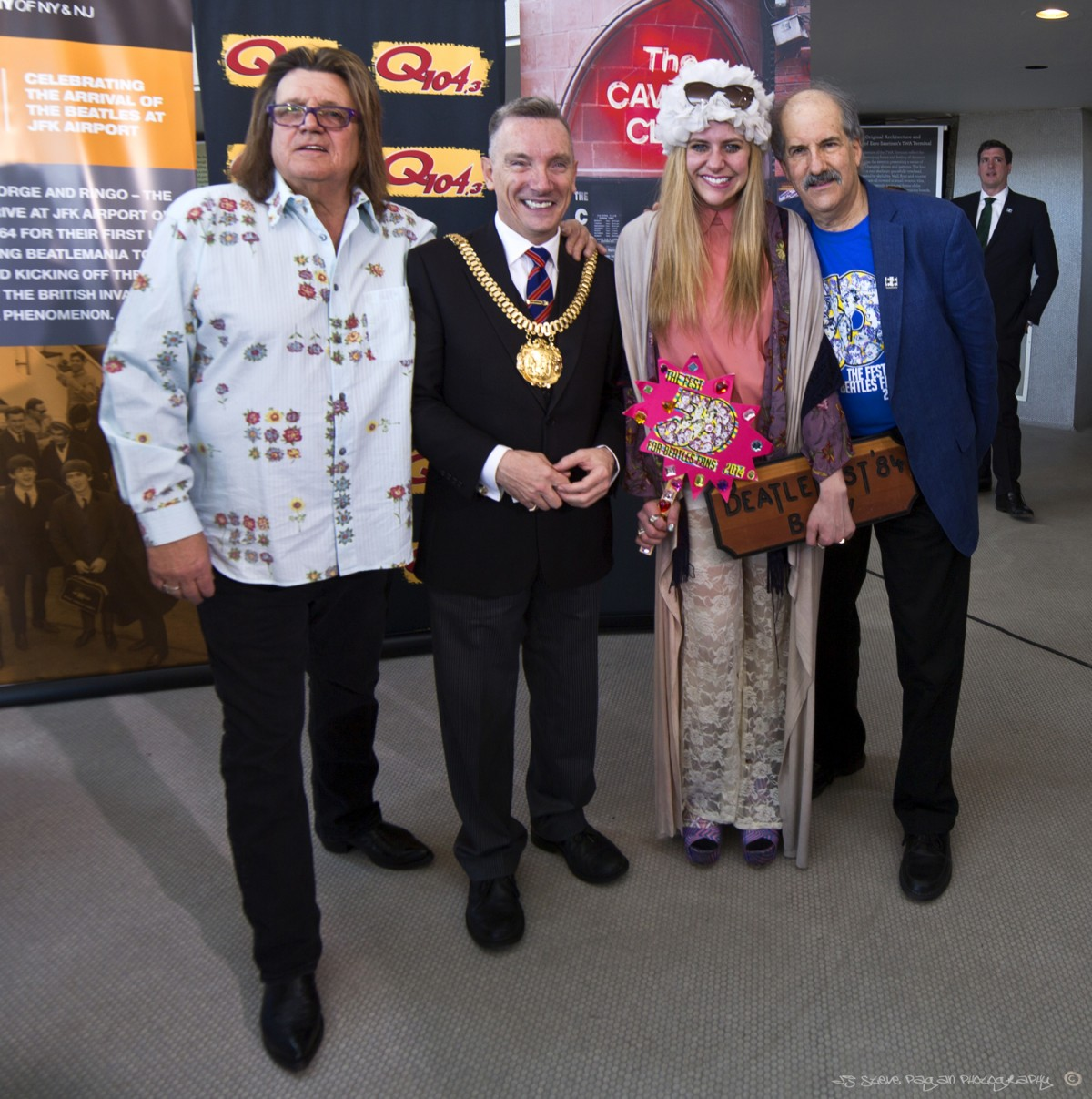 Billy J. Kramer, the Lord Mayor of Liverpool, Michelle Lapidos, and Mark Lapidos pose for a shot during the JFK Airport trip.